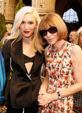 Gwen Stefani, in a bra top and blazer, posed alongside Anna Wintour in her signature brand of chic.