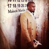 Kanye West arrived in an overcoat from the Maison Martin Margiela x H&M collection to celebrate the line's launch.