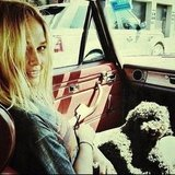 Lara Bingle kept close to a cute friend in a seriously cool-looking car. Source: Instagram user mslbingle