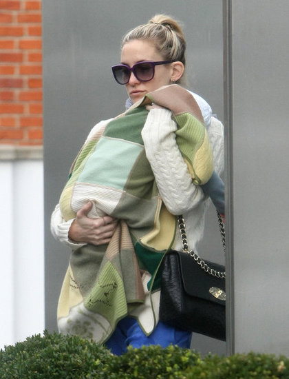 Kate Hudson carried son Bingham in London.