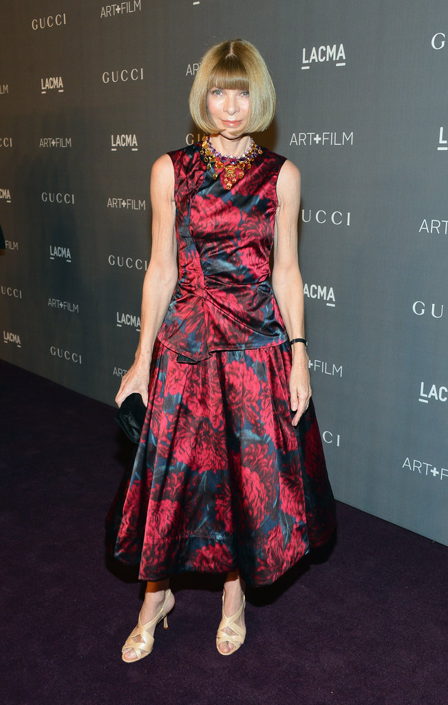 Anna Wintour outfitted a lovely print tea-length dress with her usual statement necklace and understated heels.