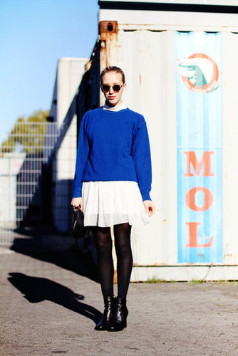 Bold cobalt and a white chiffon skirt take on a new, seasonal identity with black tights and tough-girl ankle boots. Source: Lookbook.nu