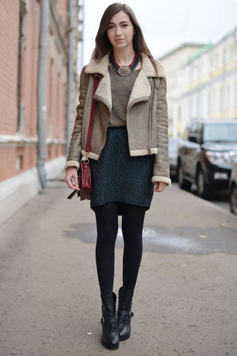 Shearling warms up a pullover and slick miniskirt, while a statement necklace glams it up. Source: Lookbook.nu