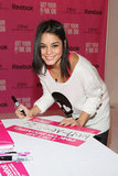 Vanessa Hudgens created a breast cancer awareness sign in NYC during October 2012.
