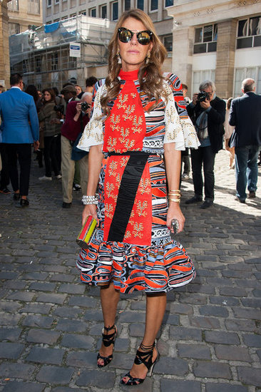 Anna Dello Russo, the queen of going for the bold, attended Paris Fashion Week shows at the beginning of the month in a vibrant, multicolored dress with heels and sunglasses.