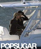 Enrique Iglesias and Anna Kournikova sat close together as they cruised around Miami.