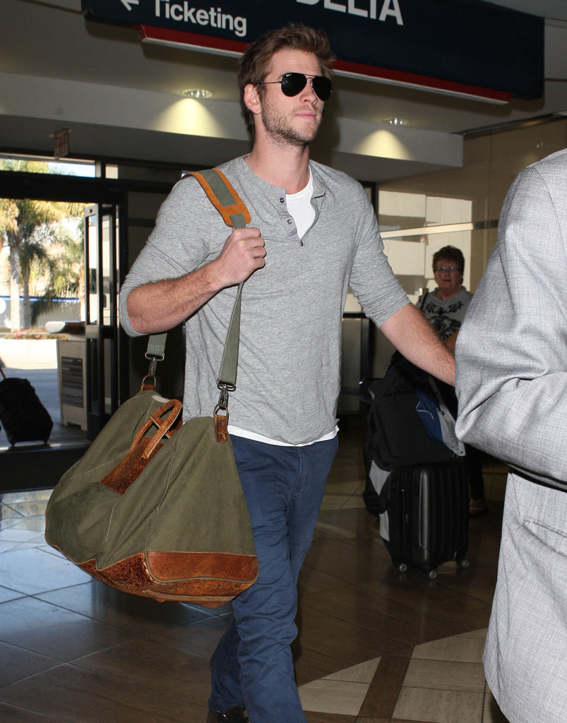 Liam Hemsworth walked through the airport in LA.
