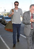 Liam Hemsworth wore jeans at the airport in LA.
