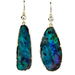 The price tag on these Irene Neuwirth mismatched opal and diamond earrings ($12,180) is quite steep, but they would spice up any ensemble, especially a classic LBD.