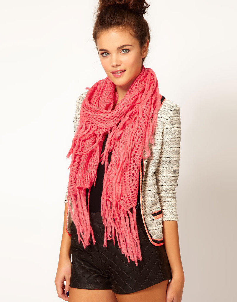 This pink River Island Tassle Scarf ($38) will had a pop of color to any Winter getup.