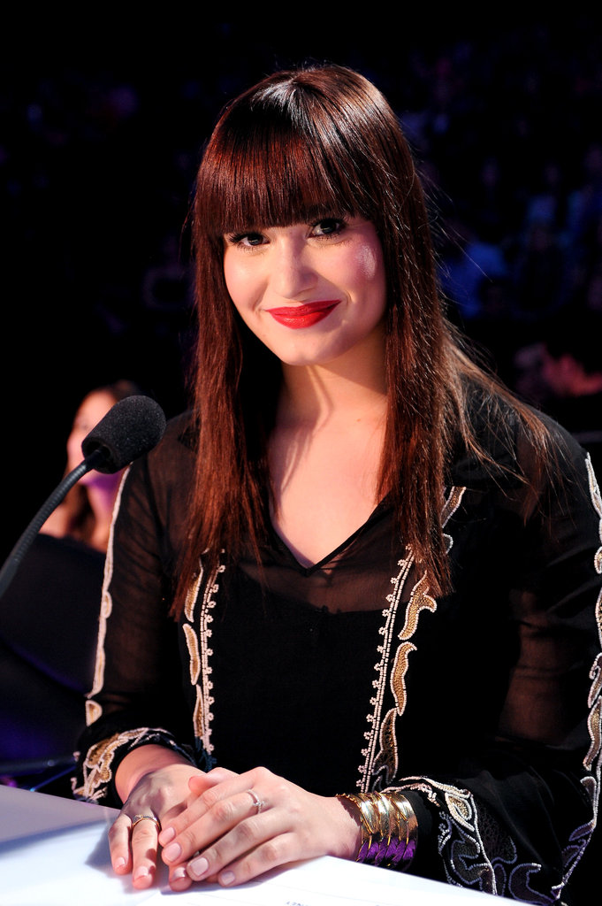 Demi Lovato flashed a smile.