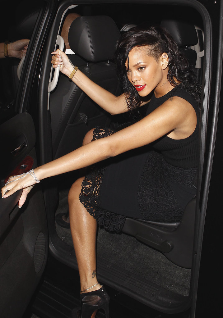 Rihanna stepped out of a car.