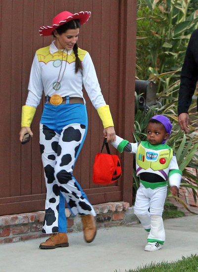 Sandra and Louis Bullock made a Toy Story match from heaven dressed as Jessie and Buzz Lightyear on Halloween in 2012.