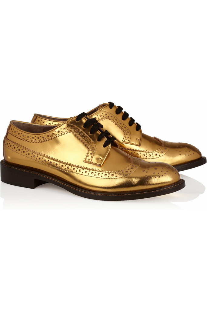 For me, the holidays are all about flash; that's why I'll be wearing these Miu Miu Metallic Leather Brogues ($685) from Thanksgiving dinner all the way until New Year's Eve. They're the perfect way to add a pop of glitz and glamour to my everyday sweater and jeans looks. — Brittney Stephens, assistant editor
