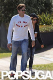 Ashton Kutcher wore sunglasses to walk in Sydney with girlfriend Mila Kunis.