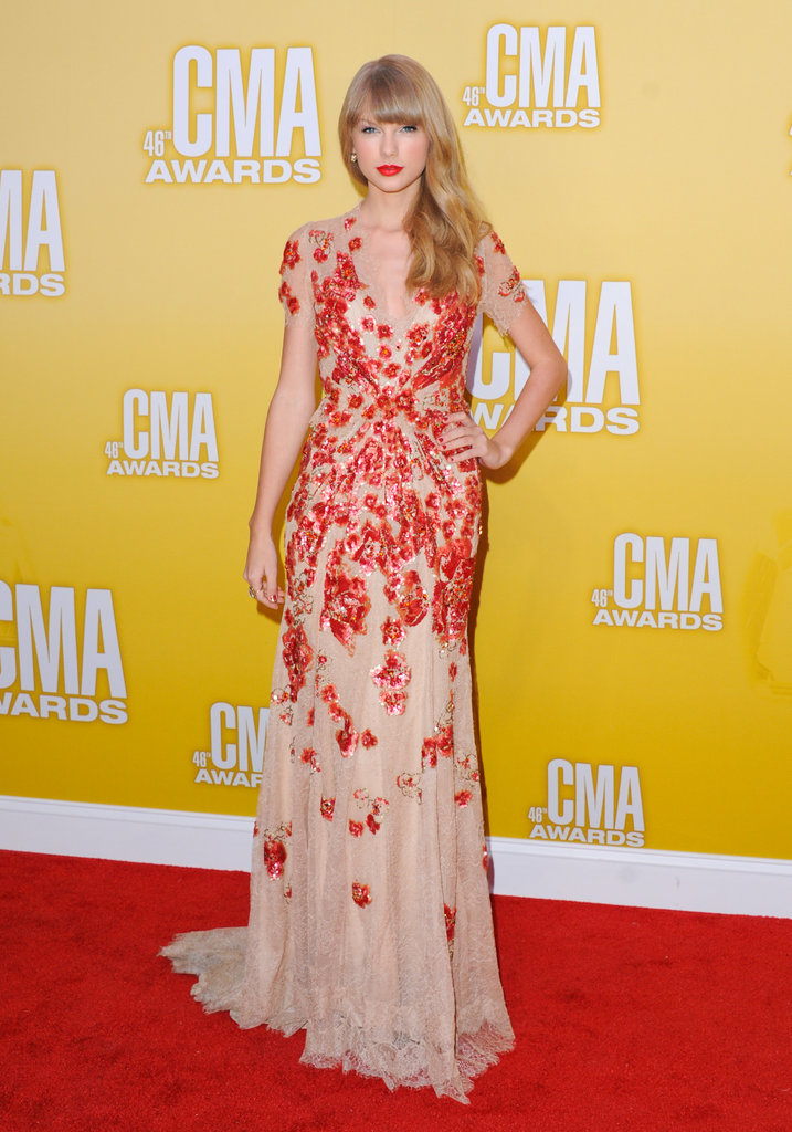 Taylor Swift didn't hold back on the dramatic glamour, and we're all the luckier for it. Her red-and-nude embellished Jenny Packham gown from the Spring '12 runway provided a more moody type of elegance than we're used to seeing on the blond singer, but we think it works well and goes perfectly with her signature matte red lip.