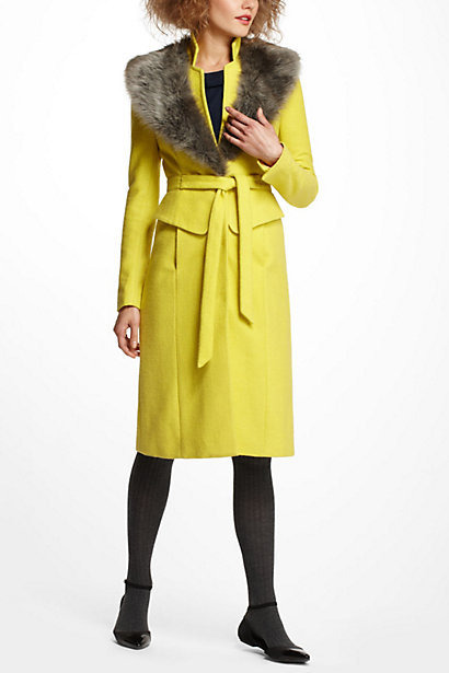 We love the bright citron hue on this Anthropologie Collared Peplum Coat ($498) — perfect for wearing with dressier Winter pieces.