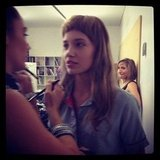 We spied a model (still in school uniform, such is life) getting primped backstage at Lisa Ho.