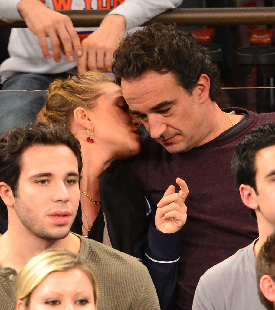 Mary-Kate Olsen gave Olivier Sarkozy a kiss on the cheek.