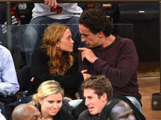Mary-Kate Olsen and Olivier Sarkozy showed PDA at the New York Knicks game.