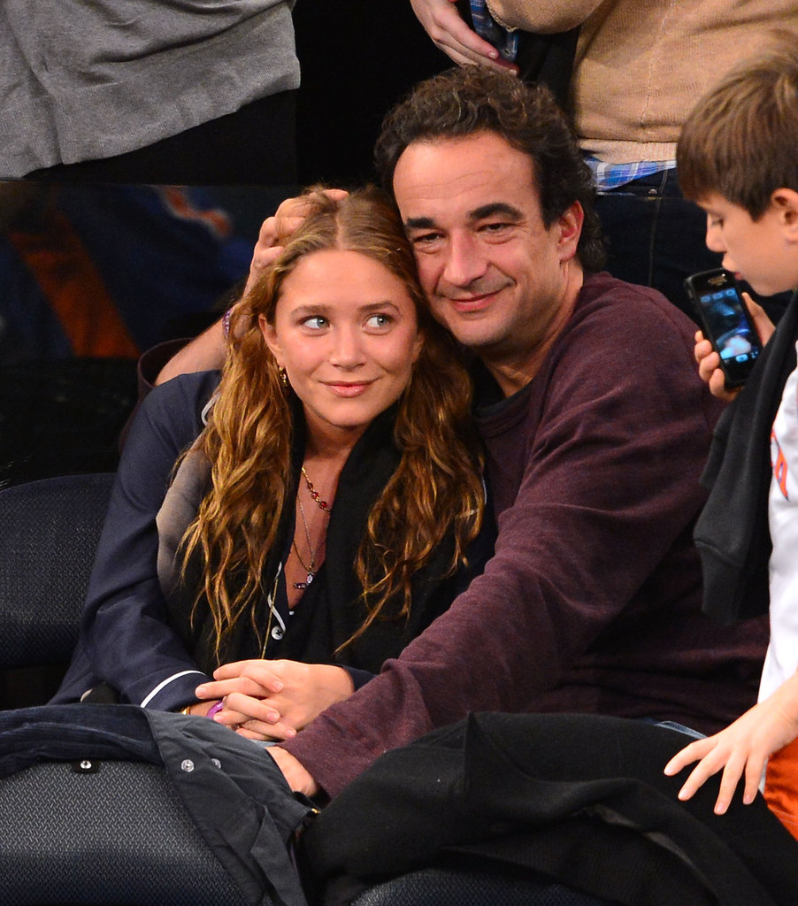 Mary-Kate Olsen and Olivier Sarkozy had their arms around each another at the game.