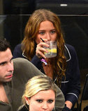 Mary-Kate Olsen sipped a beverage at the game.