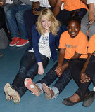 Emma Stone smiled big with a young girl while volunteering at the Boys & Girls Club in June 2012.
