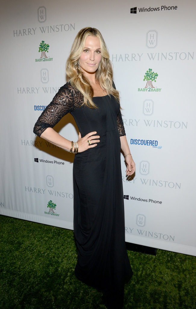 Molly Sims wore a black lace gown with bold gold accompaniments.