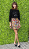 If anyone can pull off a cute, slogan sweater — it's Alexa Chung. She teamed her adorable knit with a Céline floral mini for the launch of the British Designers Collection in the UK in March of this year.