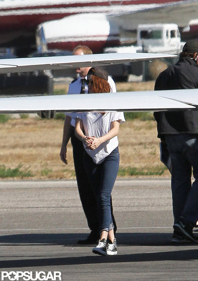 Kristen Stewart headed to a plane.