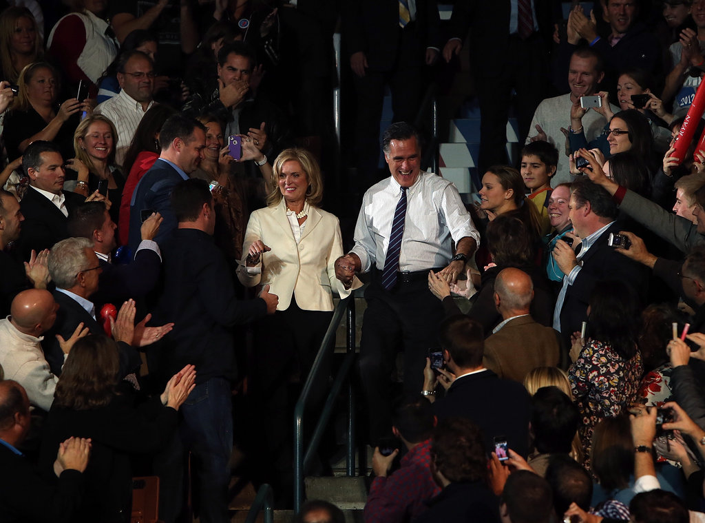 Holding hands, the Romneys greeted their fans with excitement.