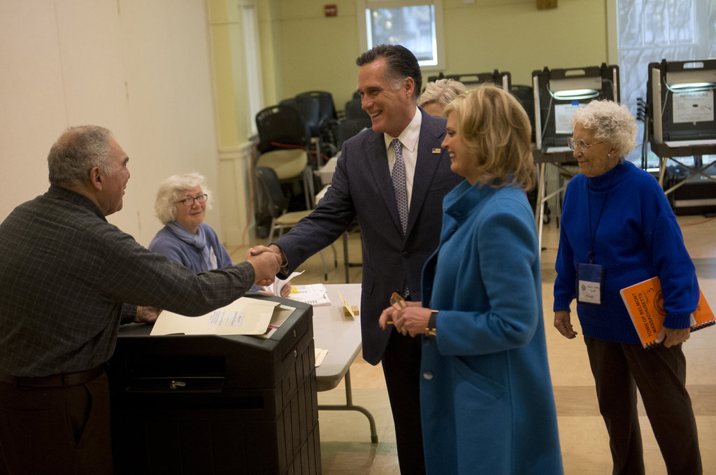 The Romneys greeted fellow voters before casting their votes.