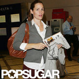 Jennifer Garner stepped out in a gray cardigan at LAX.