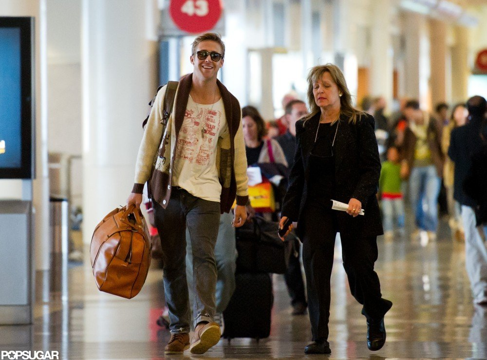 Ryan seemed to be in high spirits catching a flight out of NYC in December 2011.