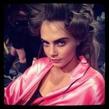 Cara Delevingne got coy for the cameras backstage at the Victoria's Secret Fashion Show. Source: Instagram user fashionologie