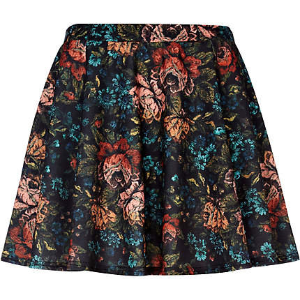Tuck a silky cream-colored button-down into River Island's Tapestry Floral Print Skater Skirt ($29) for a sophisticated work look.