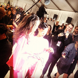 Rihanna and a VS model wore pink backstage.  Source: Instagram user badgalriri
