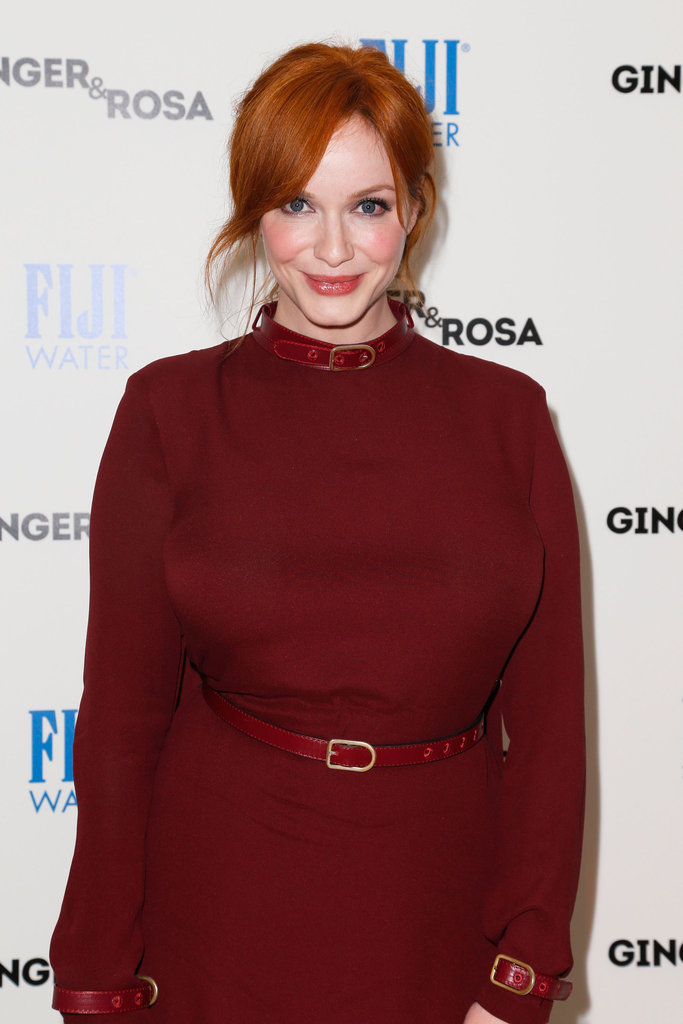 Christina Hendricks styled her hair up.