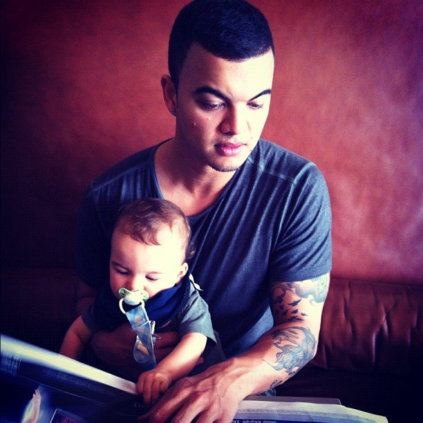 Guy Sebastian read the paper with his precious son, Hudson. Source: Instagram user guysebastian