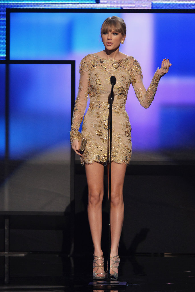 Taylor Swift stepped out in a gold dress for the awards.