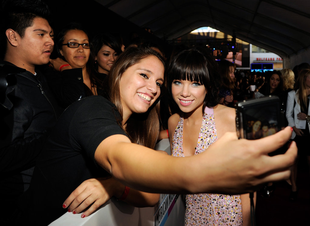 Carly Rae Jepsen posed for a photo with a fan.