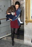 Katie Holmes had Suri on her hip leaving her Broadway show.