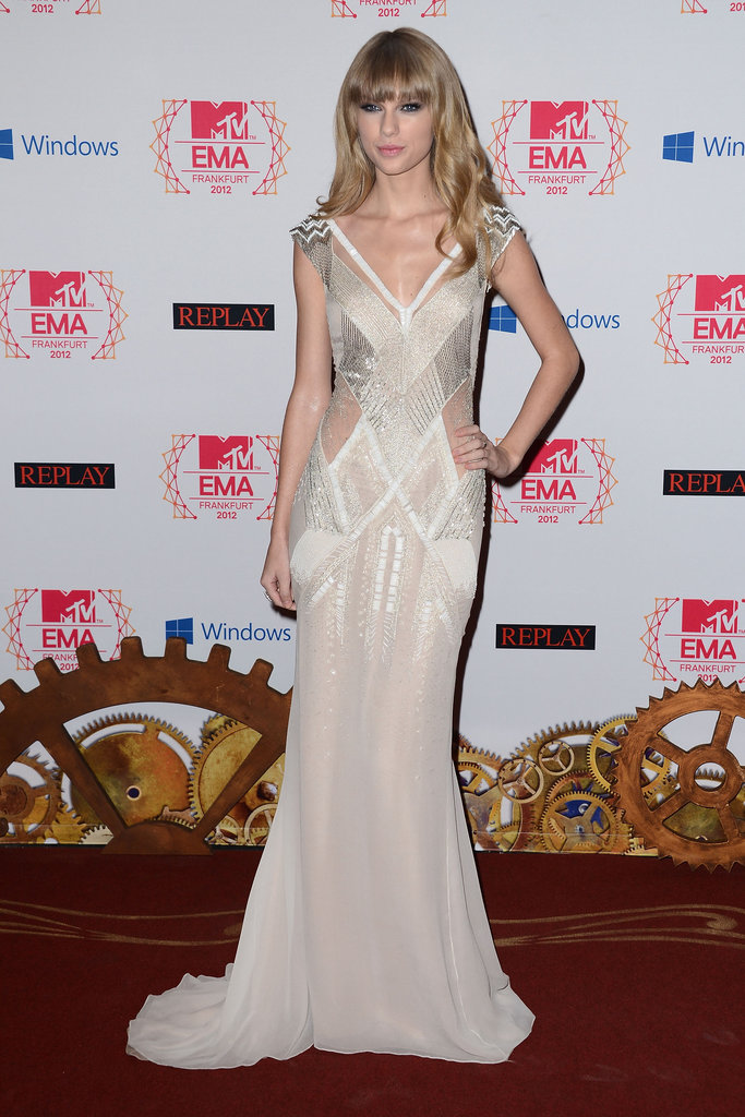 Taylor Swift in J Mendel dress, Christian Louboutin heels and Neil Lane jewels.