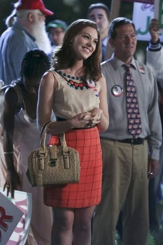 Annabeth was perfectly polished in an embellished mixed-print frock by Tracy Reese and beige Ivanka Trump tote ($122, originally $175). Tuck this beaded Topshop shell ($100) into this checkered Tara Jarmon skirt ($214) for a glamorous take on Annabeth's patriotic look.
