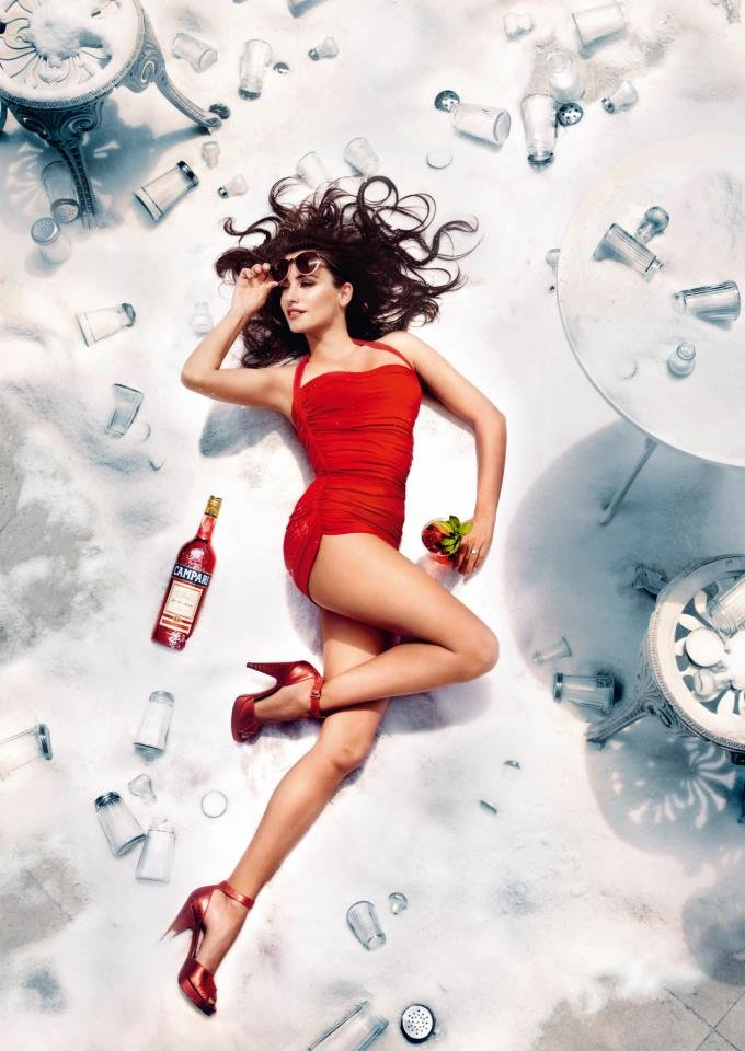 Penélope Cruz posed in a red one-piece swimsuit for Campari's superstition-themed 2013 calendar. Source: Campari