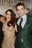 She and costar Robert Pattinson posed together, and we've got to say, the duo inspire fits of cool Winter-hued fancy in their complementary nude and forest green pairing.