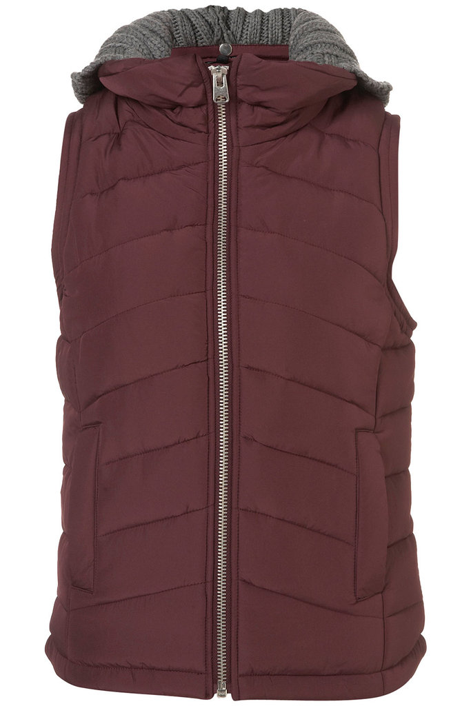 In addition to the Winter-perfect knit hood, this Topshop gilet ($110) features our favorite shade of burgundy. Layer this vest with a neutral-toned palette — or a pop of olive green! — to keep it cool and low-key.