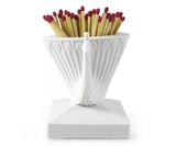 Replace less sightly matchboxes with this Peacock Match Strike ($42) — an ideal accessory for mantels or coffee tables.