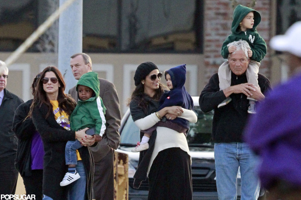 Sandra Bullock held Louis in her arms as pregnant Camila Alves carried Vida in New Orleans.