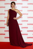 Penelope Cruz wore a burgundy dress for a cocktail party in honor of her Campari calendar.